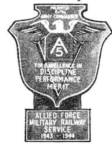 "Photo Caption: 5th Army Plaque and Clasp presented to MRS by Lt. Gen. Mark W. Clark [Inscription reads:""Presented by the Army Commander / For Excellence in Discipline Performance Merit / Allied Force MilitaryRailway Service 1943 - 1944""]"