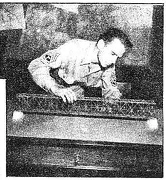 T/3 Owen Beckwith, Minneapolis, Minn., became so interested that he went to work on a scale model which he made out of cardboard, match sticks and glue.